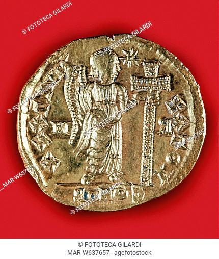 MONETE Solido d'oro di Galla Placidia. Verso della moneta con la raffigurazione di un angelo con la croce, per esprimere il forte legame fra la principessa...