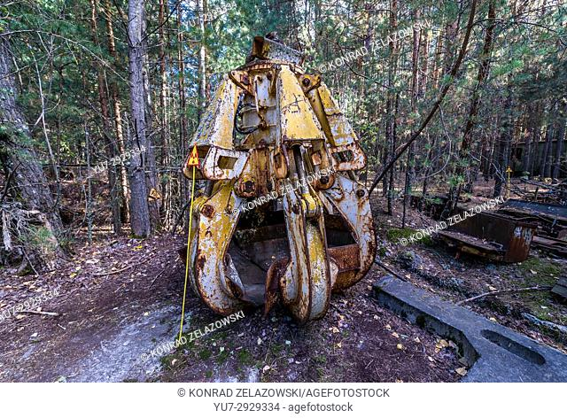 Radioactive scrap bucket in Pripyat city of Chernobyl Nuclear Power Plant Zone of Alienation around the nuclear reactor disaster in Ukraine