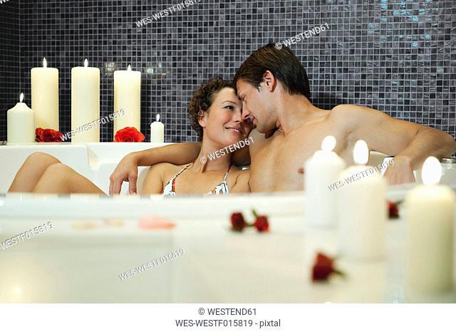 Italy, SouthTyrol, Couple having romantic bath in hotel urthaler