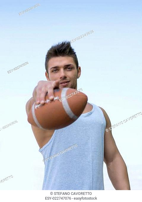Muscular american football with ball in hand