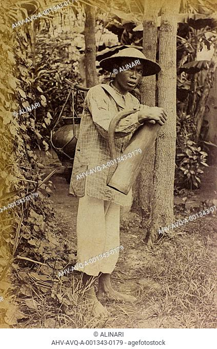 Chinese young man carrying a container, shot 1890-1900