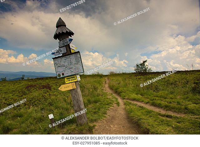 Bieszczady,Poland-JULY 08,2014: Tourist trail leading to Muczne with information sign next to