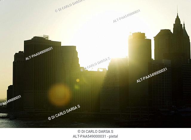 Silhouette of city skyline at sunset