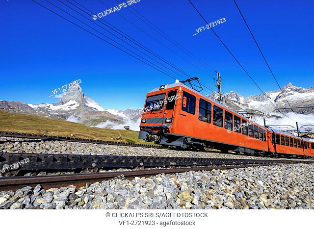 The swiss Bahn train runs on its route with the Matterhorn in the background Gornergrat Canton of Valais Switzerland Europe