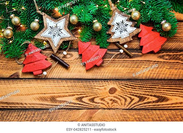 Christmas red gold vintage decoration with green fir branch over dark wooden background. Flat lay, text space