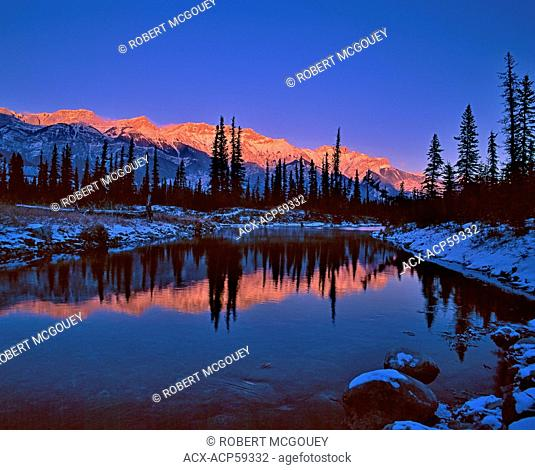 An alpenglow sunset on the Miette Mountain Range in Jasper National Park,Alberta,Canada