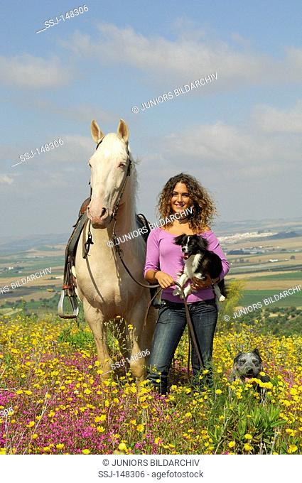 girl with two dogs and Lusitano
