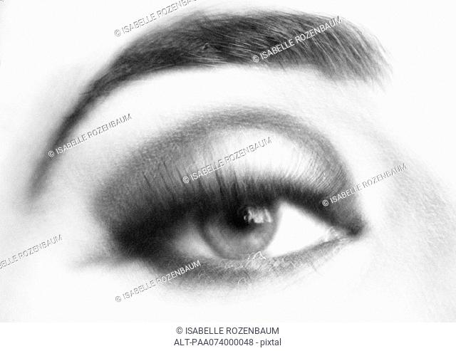 Woman's made-up eye, close-up, blurry, black and white