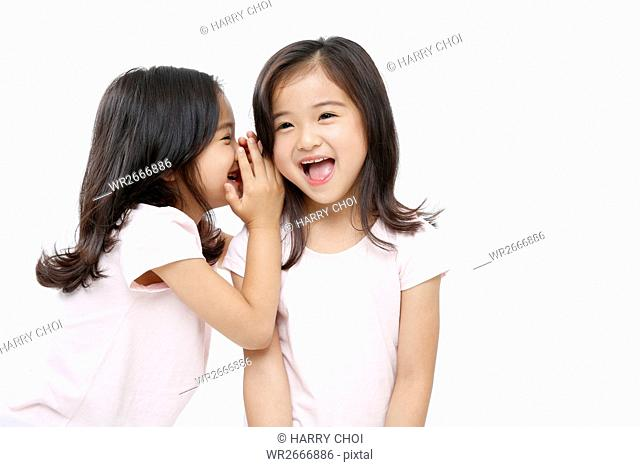 Portrait of smiling twin girls