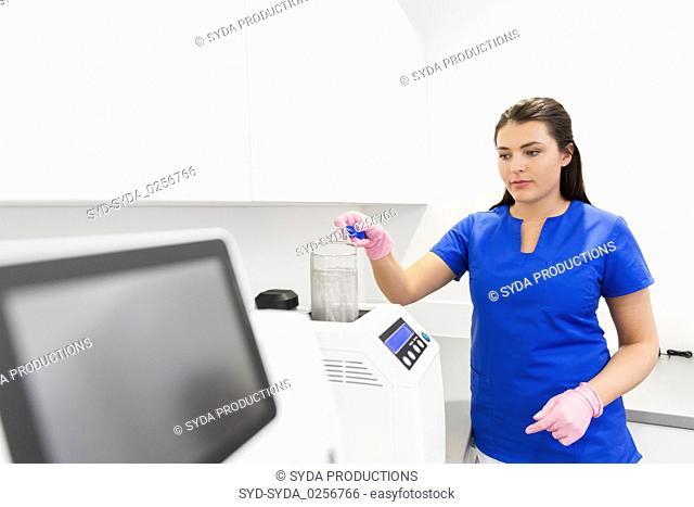 dentist sterilizing tools at dental clinic