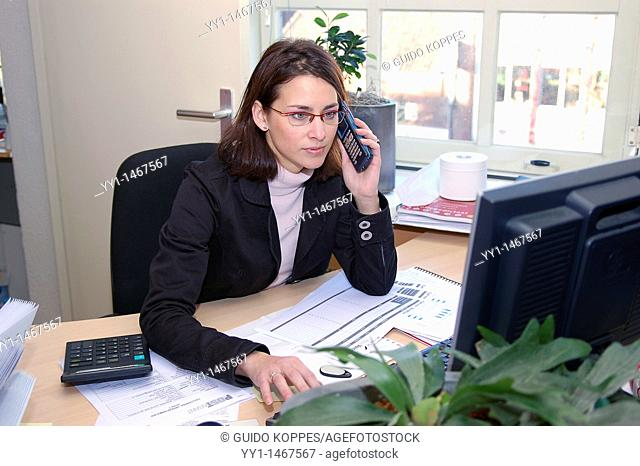 Young, attractive woman working in the office of a callcentre