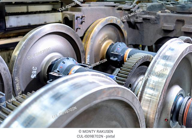 Locomotive wheel sets in train works, close up