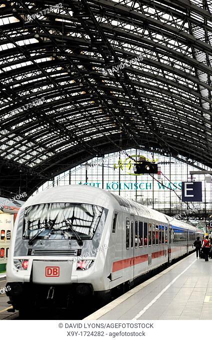 Deutsche Bahn DB high speed German intercity passenger train standing at platform in Cologne railway station, Germany