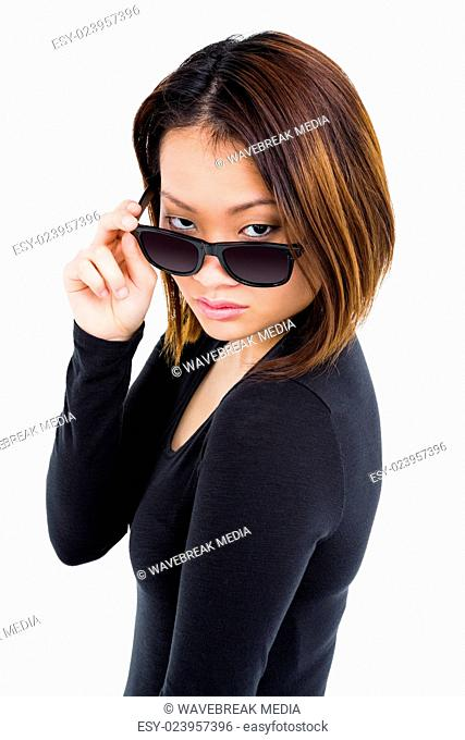Woman looking over her sunglasses