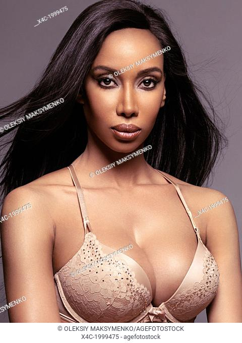 Beauty portrait of glamorous black woman with long straight hair wearing lingerie