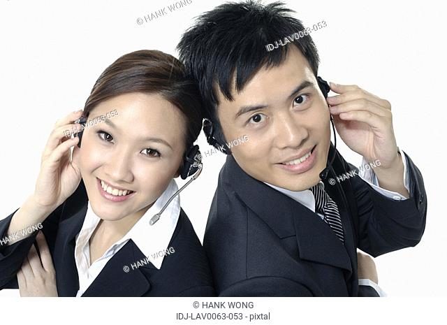 Portrait of a male and a female customer care executives smiling