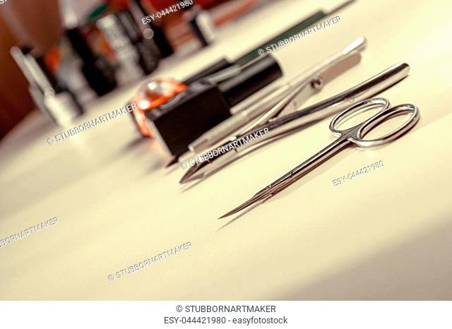 tool for manicure on white table proffesional
