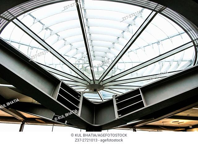 Natural light streams in through the ceiling in the modern office building of the Rolls Royce plant, Chichester, England