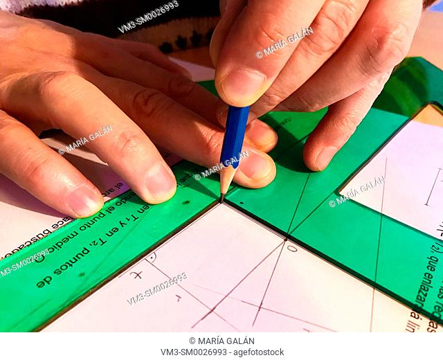 Man using right triangles and pencil. Technical Drawing