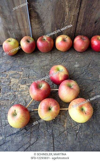Apples stuck on wooden skewers to make the shape of a tree