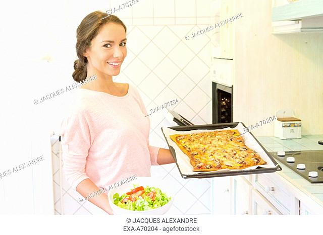 Woman in the kitchen at the oven