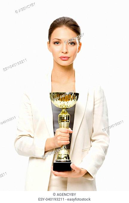 Half-length portrait of business woman keeping golden cup, isolated on white. Concept of victory and success