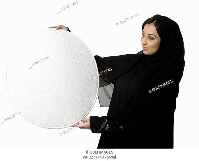 Young woman holding blank placard