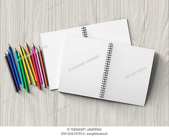 color pencil on checked notebook on wood background, stationary object
