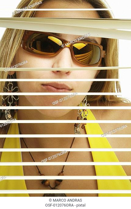 woman looking through the window with sunglasses