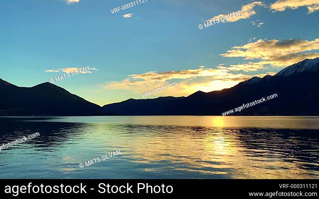 Alpine Lake with Mountain in Sunset in Ascona, Switzerland