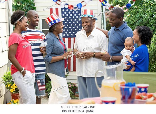Multi-generation family enjoying Fourth of July party