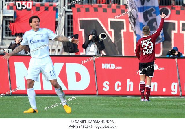 Nuremberg's Alexander Esswein celebrates his 2-0 goal next to Schalke's Jermaine Jones (L) during the German Bundesliga soccer match between 1