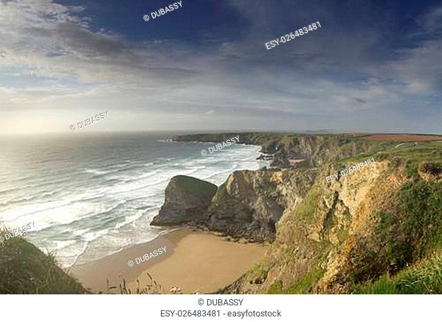 the stunning coastline at bedruthan steps at sunset on the north cornwall coast, england
