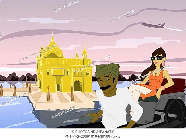 Woman sitting on a rickshaw in front of a temple, Golden Temple, Amritsar, Punjab, India