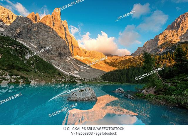 Sorapiss Lake, Dolomites, Veneto, Italy. Sunrise in the Sorapiss group. In the Sorapiss Lake reflected the Dito di Dio (God's Finger)