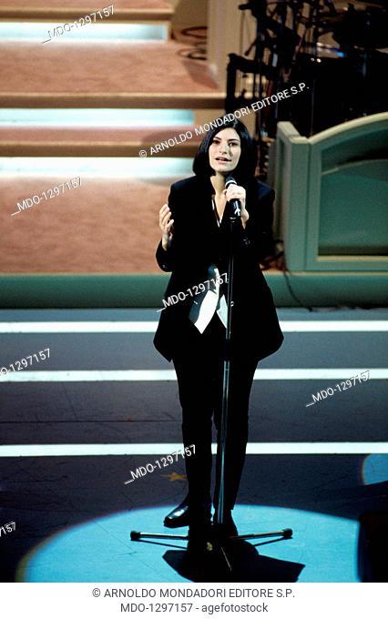 Laura Pausini at Sanremo Music Festival. The Italian singer Laura Pausini singing on the stage of Teatro Ariston during the Sanremo Music Festival