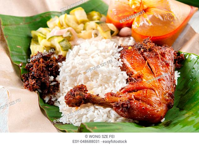 Nasi lemak kukus with chicken, popular traditional Malay local food