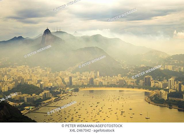 View from Sugarloaf TO - Cristo Redentor German Christ the Redeemer is a 30 meter high statue of Christ in Rio de Janeiro Brazil on the Corcovado Mountain in...