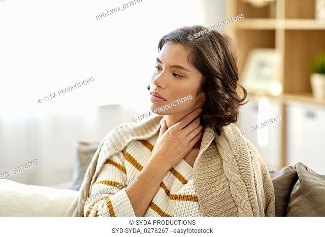 unhappy sick woman with sore throat at home