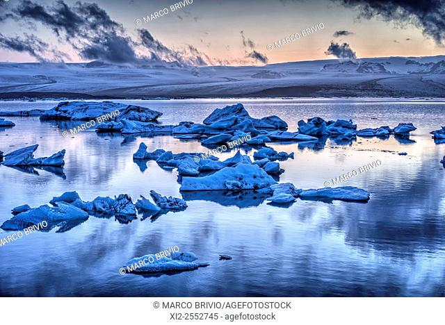 Midnight light at Jokulsarlon, a large glacial lake in southeast Iceland on the edge of Vatnajokull National Park. Situated at the head of the...