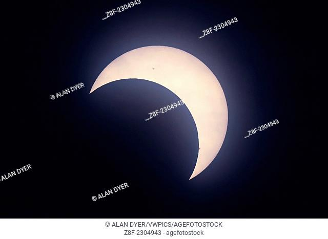The partial solar eclipse as seen from Calgary, Alberta, on May 20, 2012, but seen as an annular eclipse from the SW United States