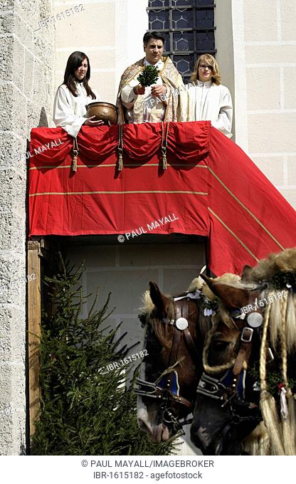 Priest blessing the horses, Saint George horse parade, Traunstein, Upper Bavaria, Germany, Europe