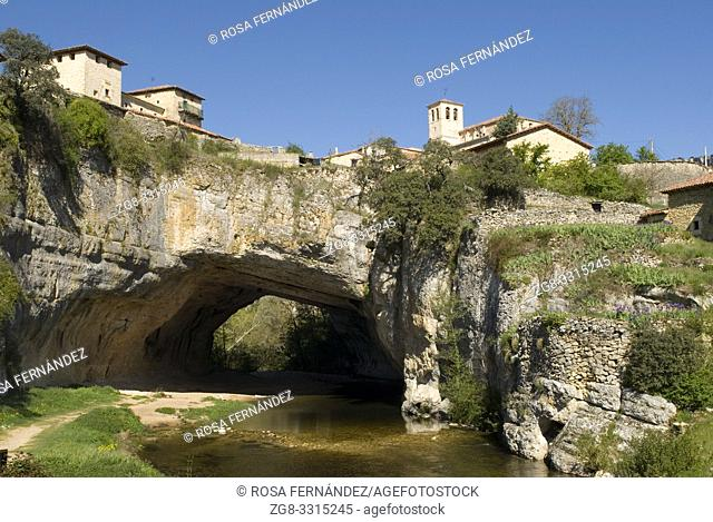 Nela River and village of Puentedey, located over a natural bridge excavated by the water, Las Merindades, province of Burgos, Castilla y Leon, Spain
