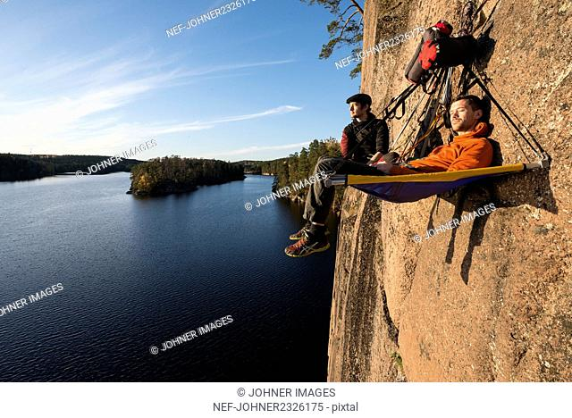 Two hikers resting in portaledge