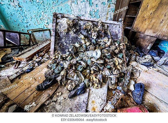 Old gas masks in abandoned Jupiter Factory in Pripyat ghost town of Chernobyl Nuclear Power Plant Zone of Alienation in Ukraine