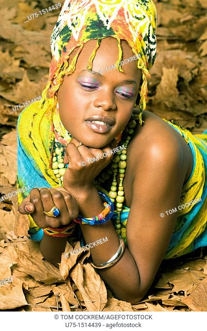 African model with autumn leaves in studio setting