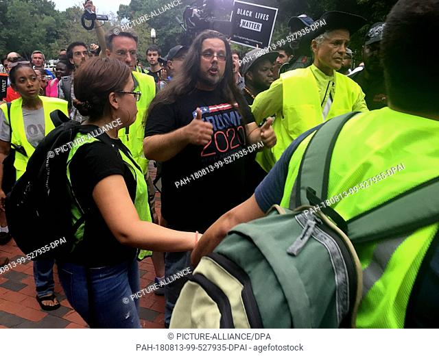 12 August 2018, USA, District of Columbia, Washington: During a demonstration against an extreme right-wing march in front of the White House on the anniversary...