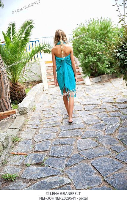 Girl walking, rear view