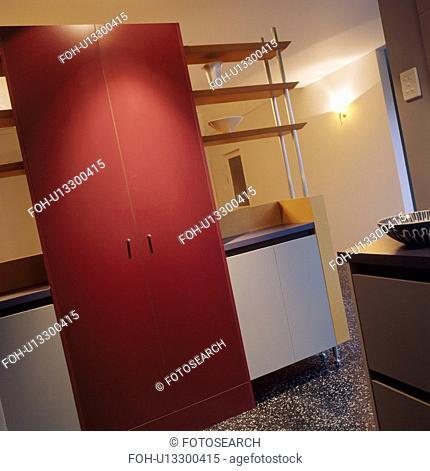 Pink cupboard doors in modern kitchen