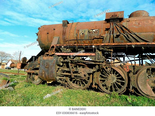 Large, old steam locomotive, which for years waiting for repair and Museum